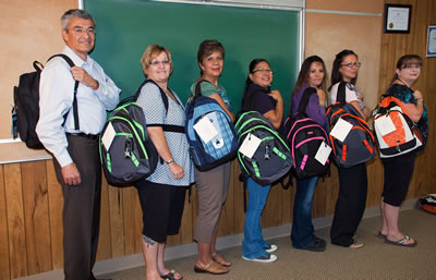 CDEC members showing off the new backpacks for students
