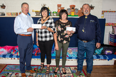 Check presentation at Casa San Jose Child Care and Behavioral Health Center in Milan, N.M.